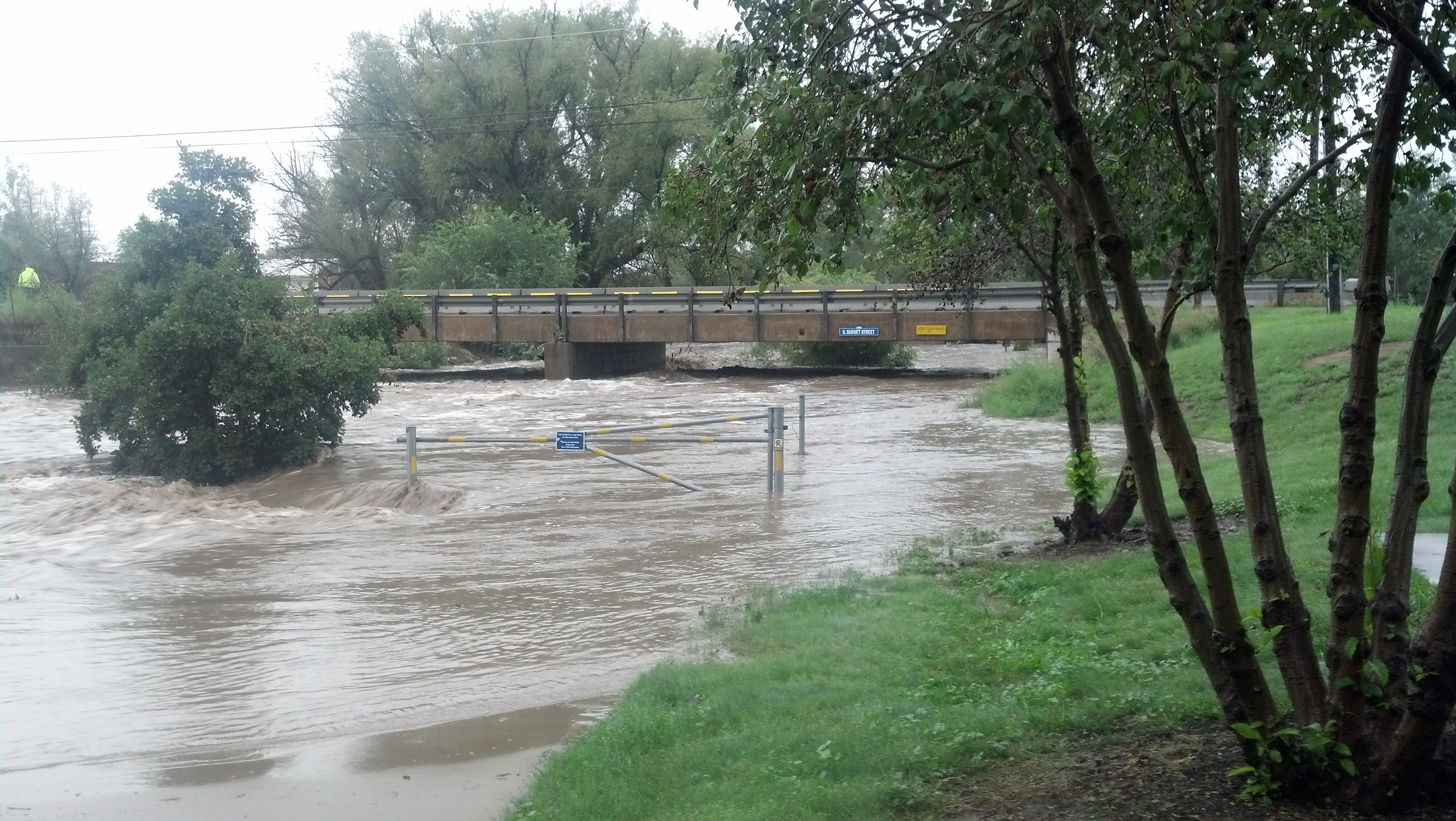 Listening to the train barrier warning bells, the lights flashing, but it's the St. Vrain rushing by…